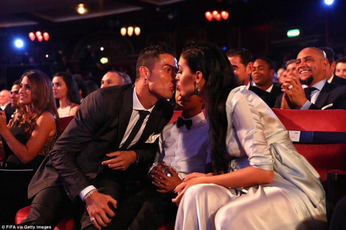 Ronaldo kisses girlfriend Georgina Rodriguez after being named best footballer in the world for the second year in succession