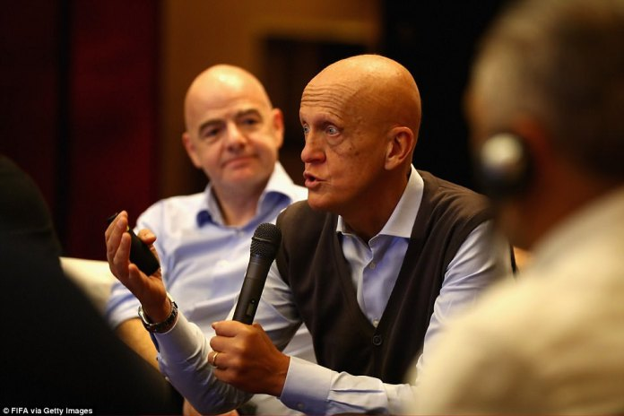 Pierluigi Collina speaks during the FIFA Legends Think Tank as president Gianni Infantino looks on in the background