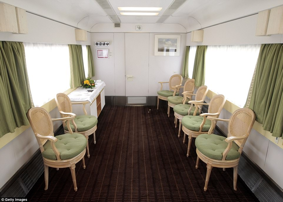 Photographs of inside the train show how the decor is a lot more functional now. Pictured are chairs situated in The Duke of Edinburgh's Carriage aboard the royal train, featuring a neutral colour scheme