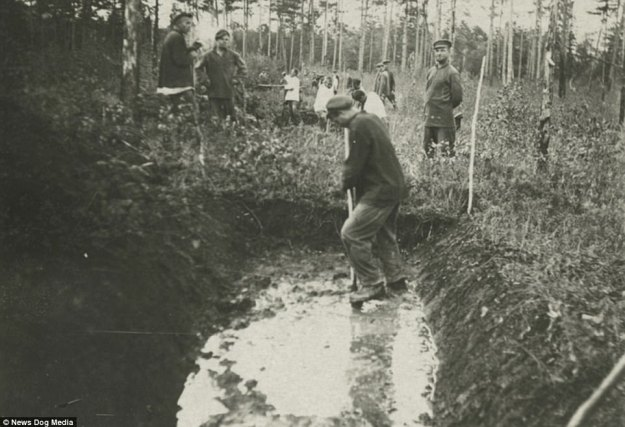 Prisoners in a Soviet gulag dig a ditch as a guard looks on in 1936. The convicts in these labour camps could work up to fourteen hours per day. Typical gulag labor was exhausting physical work, as prisoners cut down trees and worked in mines, often suffering painful and fatal lung diseases from inhalation of ore dust. Prisoners were barely fed enough to sustain such difficult labor