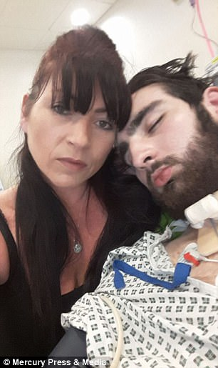 He is pictured in hospital with his mother Helen