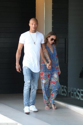 Casual: Brief reality star Chloe opted for a plunging floral jumpsuit for the occasion