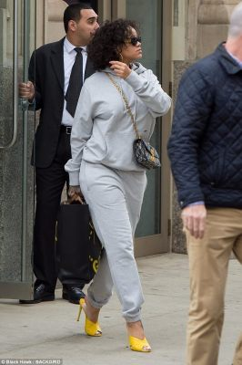 Making the sidewalk her runway: The 29-year-old singer glammed up her sweatsuit with bold yellow heels and two luxury handbags