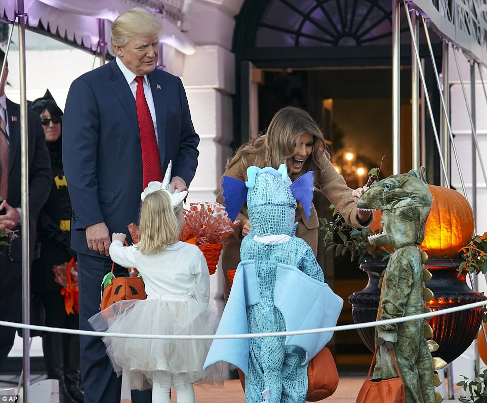 First lady Melania Trump (right) was more at ease when several, smaller dinosaurs came through the line