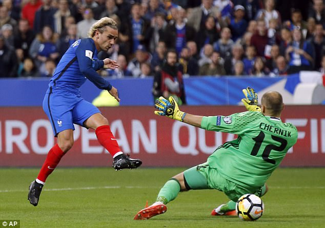 Antoine Griezmann slots past Belarus goalkeeper Sergei Chernik in last month's clash in Paris