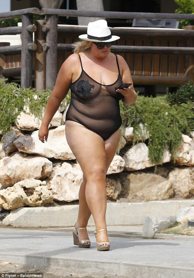 Skimpy: The suit then cut off high at her hip to leave all of her long legs on show