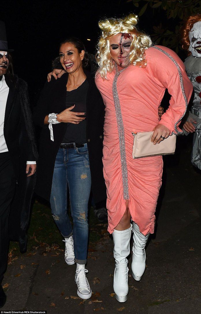 Feeling left out? Alan looked in great spirits as he cosied up to gal pal Melanie - who didn't dress up for the party