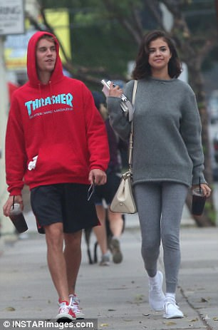 Giddy: The stars appeared to be having a blast during their outing together, which included a stroll and a biking session