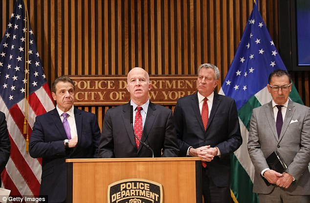 New York City Police Commissioner James O'Neill (center) stands with New York Governor Andrew Cuomo and (left) and Mayor Bill de Blasio during a news conference about the attack on Wednesday