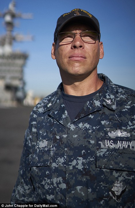 Petty Officer 3rd class Joseph Newman, a 42-year-old nine-year veteran of the US Navy from Evansville, Indiana, is in charge of communications on the flight deck