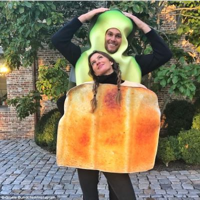In good humor: On Halloween, Tom and Gisele dressed in playful Halloween costumes; Tom had an avocado costume while Gisele was in a toast one