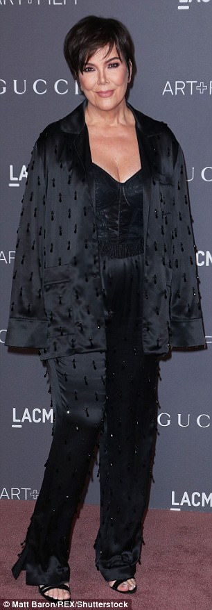 Momager: Kris Jennerlooked good in an all-black outfit consisting of a silk jacket, top, and trousers