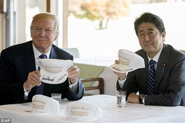 Image result for Trump and Abe exchange golf caps