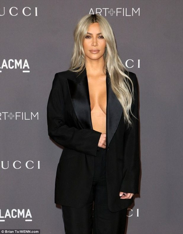 Loving it: Kim cut a sensational and stylish figure on the red carpet
