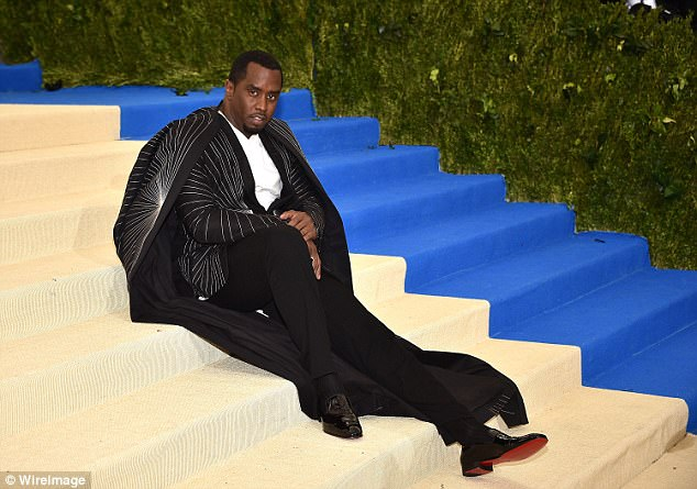 So stylish: Diddy, as he was then, poses up a storm at the Met Gala back in May