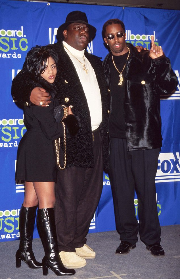 At the Billboards in 1995 with Lil' Kim and the Notorious BIG in 1995; then a record producer, Sean John Combs had yet to change his name - or release his first track as an artist