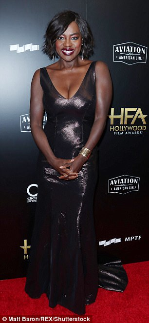 Dramatic look: Viola Davis, 53, put on a busty display in a very low-cut sleeveless black dress. The gown hugged her hips and fell in a full skirt to the floor with a small train