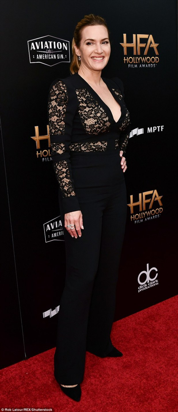 Flawless: Kate Winslet also flashed her cleavage in a lacey black jacket with plunging neckline. She paired the peek-a-boo top with black flared pants and pointed tow black pumps