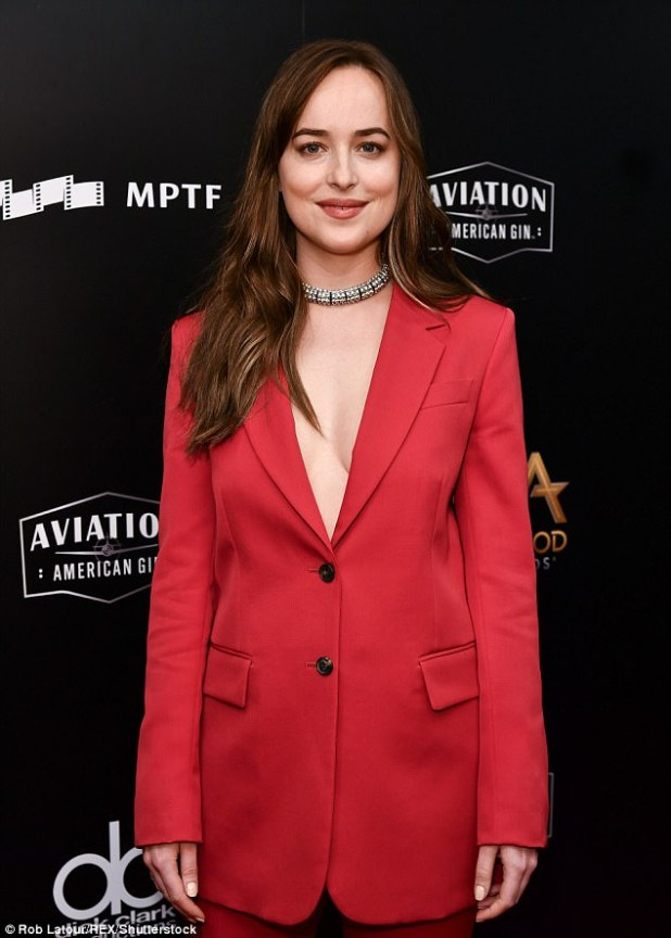 Made up: The Fifty Shades star left her long brown hair loose. She added dark red lip color and black mascara with penciled in dark brows