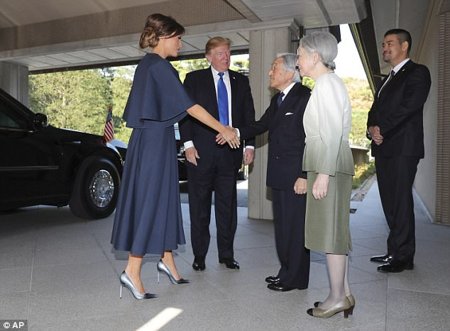 American first lady Melania Trump also towered over Emperor Akihito and Empress Michiko as they met on President Trump's second day in Japan