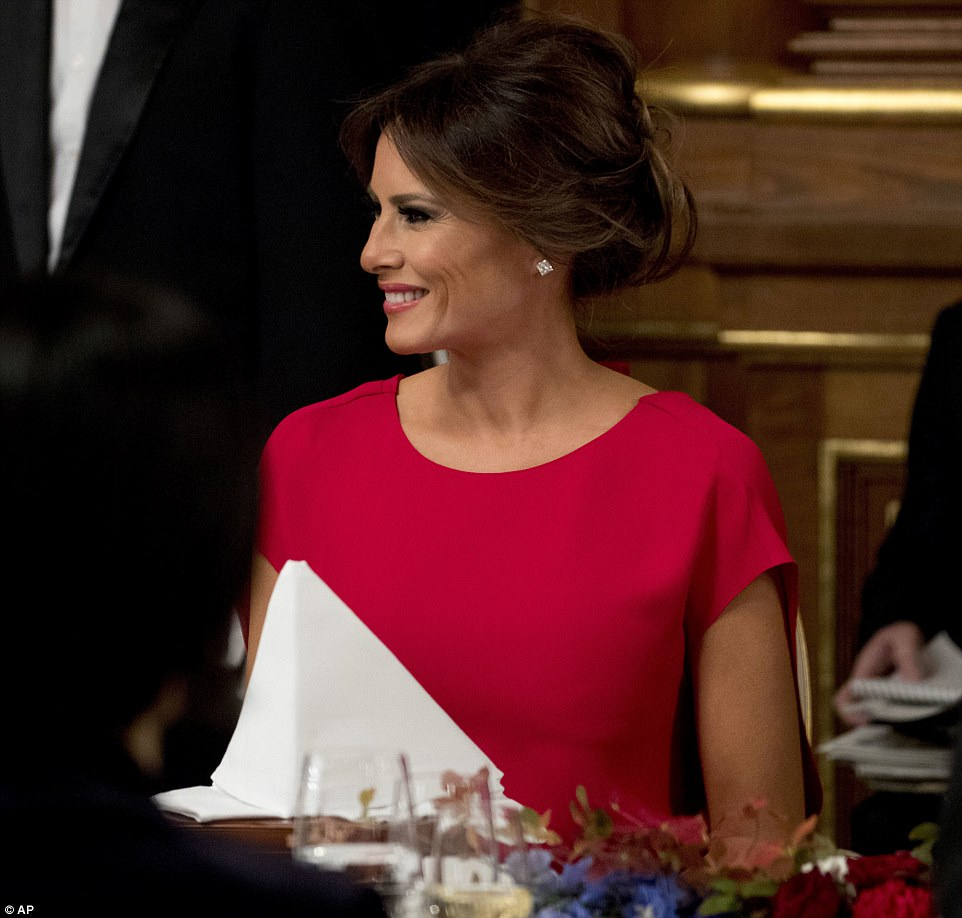 Glamorous: The first lady, 47,donned a bright red, floor-length gown with short sleeves on the occasion, wearing little jewelry for the event, which washosted by Japanese Prime Minister Shinzo Abe at the Akasaka Palace