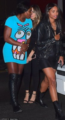 Group: Serena wore a bright blue mini dress with a funny face on it, paired with black knee-high group. Ciara went with a black dress and black lace-up boots with a leather jacket