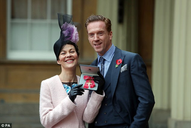Honoured: The Peaky Blinders star, 49, could not contain her joy as she proudly posed after her Investiture ceremony with husband Damian Lewis, and the honour in hand
