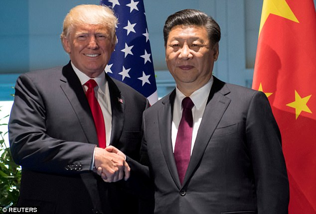 Trump is due in Beijing on Wednesday where he will meet Chinese leader Xi Jingping on his home soil for the first time (the two are pictured at the G20 summit in Germany in July)