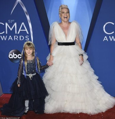 Girls only! Pink looked angelic in her fluffy white gown as she held hands with her daughter, Willow Sage Hart