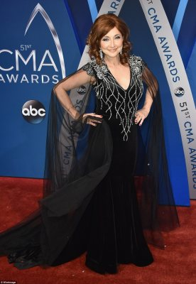 Glamorous! Pam Tillis dazzled in a dramatic black gown with cape