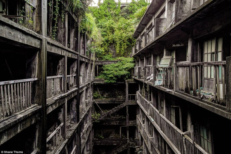 A crammed apartment complex on Hashima Island. In place of what was once a suffocatingly crammed community that lived on top of each other, sits a deserted and enchantingly dark ghost city