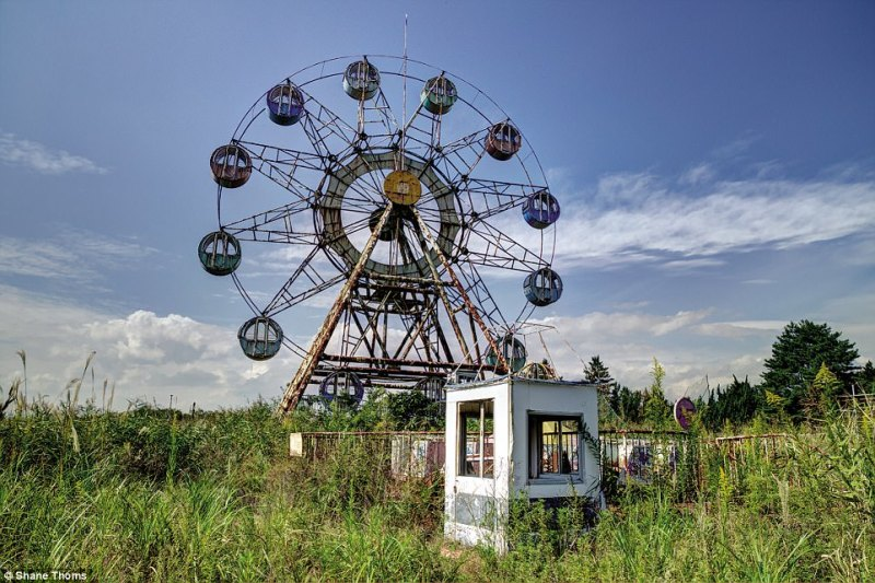 This weather beaten Ferris wheel at Nara now sits decayed among overgrown weeds and shrubs