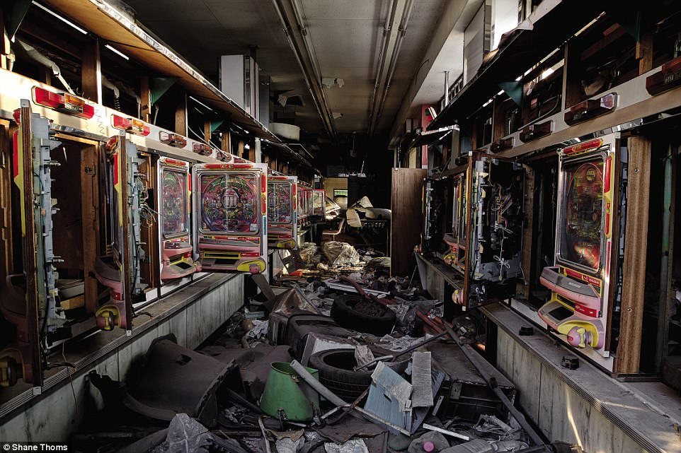 An abandoned Pachinko and slot parlor in Saitama Prefecture: 'This rubbish littered building had a 1990's feel and was filled with mosquitos and wasps. It was a little moody and melancholic because the desperate gambling addictions of its former patrons still lingered in the space,' says Thoms