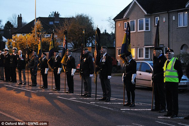 Former serviceman and women line the streets in a mark of respect to the Royal Marine on Wednesday evening