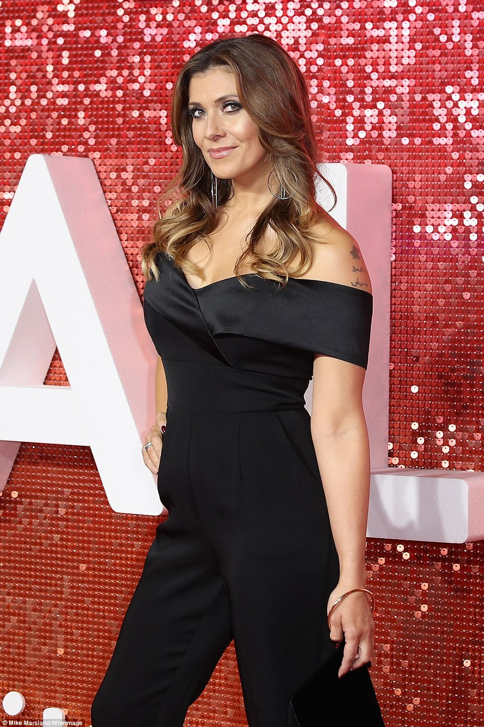 All-in-one delight: Kym Marsh, 41, looked incredible in a slinky black jumpsuit with a chic Bardot neckline