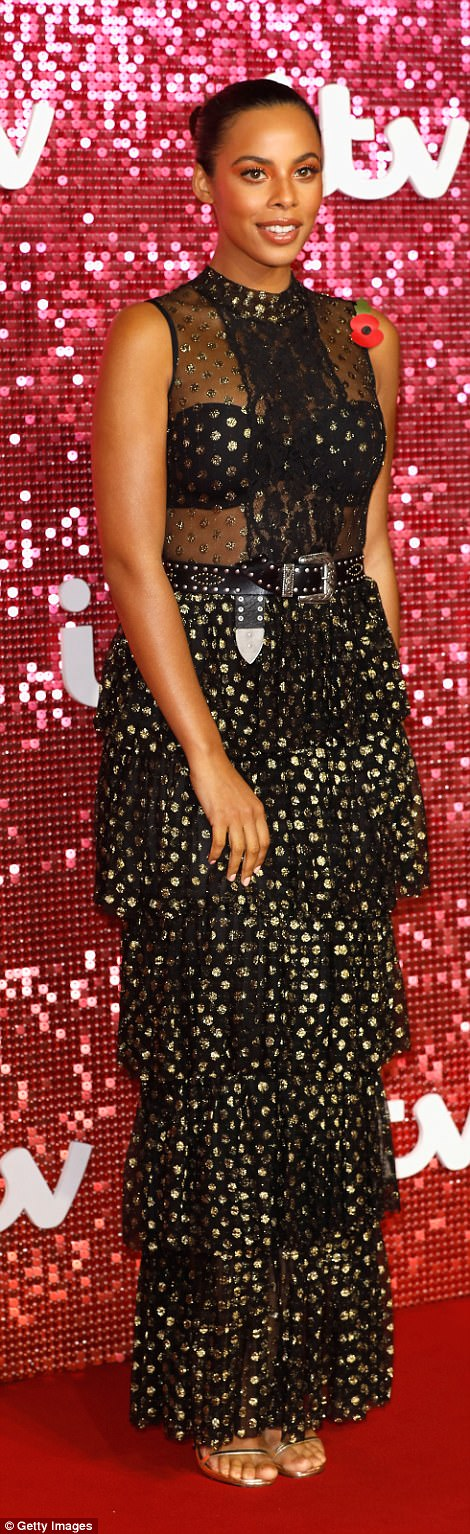 Going dotty! Rochelle Humes stunned in a semi-sheer black gown featuring decadent gold polka dots and a Victoriana-style ruffled bodice
