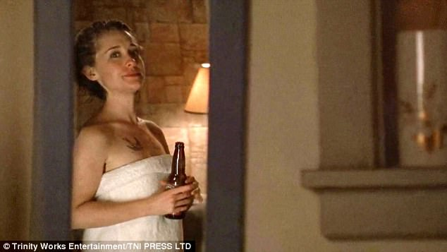 Wrapped up:The racy scenes end with Allison wrapped up in a white towel and drinking a beer as she reveals a large chest tattoo