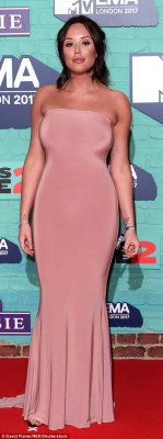 Nude ambition! The sleeveless bold look showcased every inch of the physique, before falling into a glamorous train