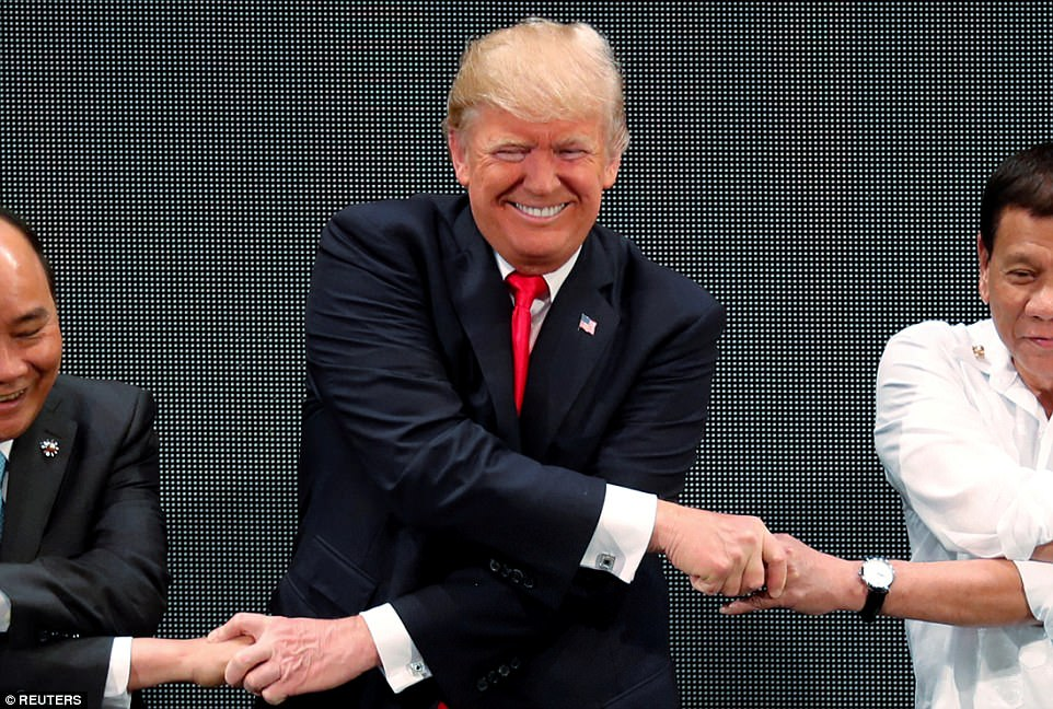 THAT'S THE TICKET: Trump broke into an uneasy smile after mastering the confusing cross-ways handshake