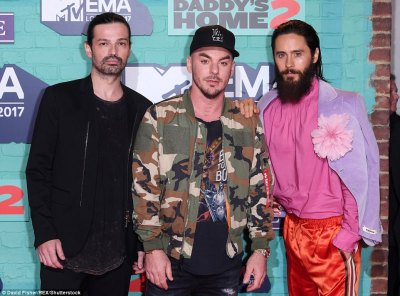 Multi-talented: Jared looked in high spirits as he posed with his band Thirty Seconds to Mars