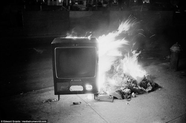 A television set burns in the street on Bowery, in New York. The Lower East Side used to be among the most deprived and depraved areas of the city, but is now one of its most desirable neighborhoods