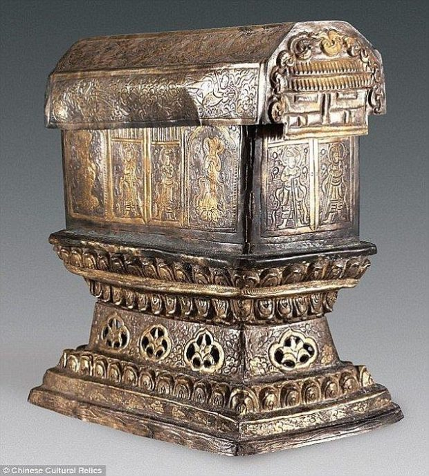 The gold chest containing the relics is held within a larger silver chest (pictured). Engraved in the gold and silver boxes are ornate images of lotus flowers, phoenixes and guardians of the box