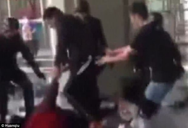 The officer single-handedly rescues the woman and captures the man by his impressive moves