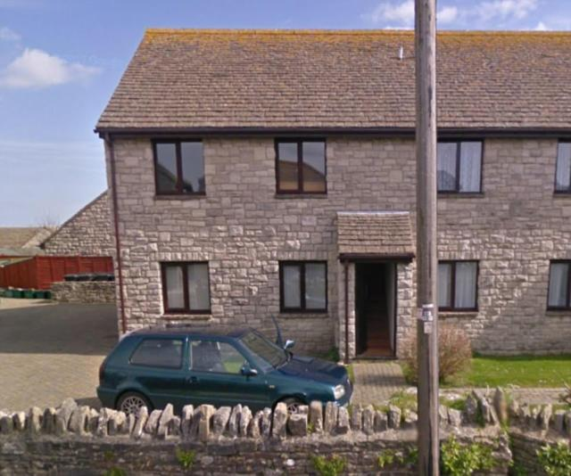 Paul Elsey's VW Golf, pictured above outside the property he shares with his mother Rosemary Dinch, has been seized by police while the home remains cordoned off by officers