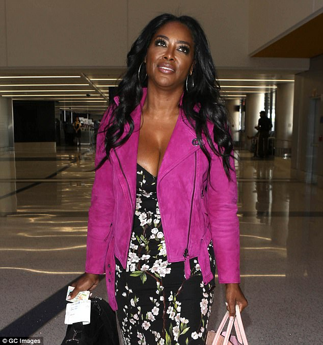 Fly girl: Moore explained that her entrepreneur husband was still living in New York while she stayed in Atlanta and that he was struggling to deal with her fame. Seen here in September