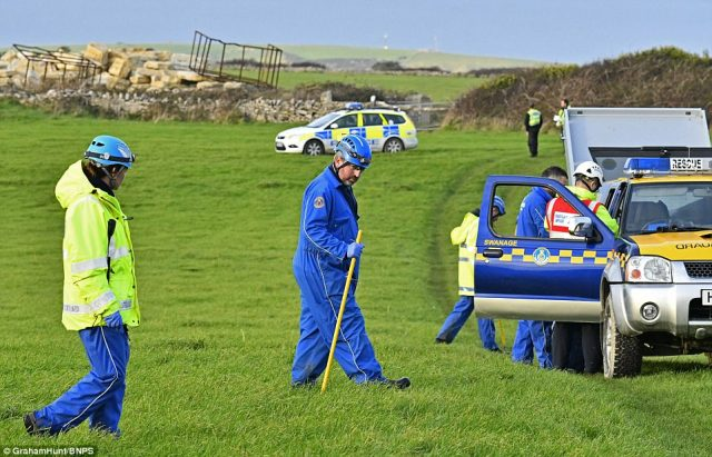 A large number of police vehicles including some containing specialist search equipment arrived to search fields near the southfacing cliffs on Thursday