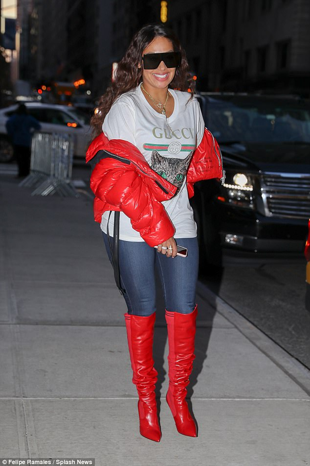 City chic:La La Anthonywas sporting designer pieces from head to toe, including a pair of $1,300 Fendi boots and a $500 Gucci T-shirt, as she stepped out in New York City on Tuesday
