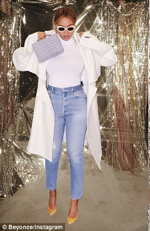Queen Bey: In other snaps she shared, she wore a white turtleneck paired with faded blue jeans and a white overcoat along  a pair of gold pumps