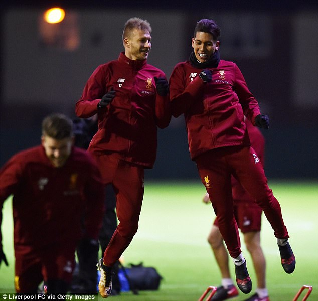 Ragnar Klavan and Roberto Firmino join in the fun during a session under the lights at Melwood