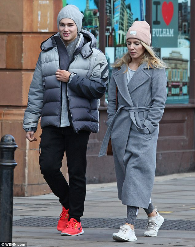 Low-key: Mollie was ready for action beneath her heavy coat as she sported skin-tight gym leggings and trainers while peeling on a grey overcoat with a waist-defining tie and a pink beanie with her hair falling from underneath